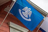 French Quarter, New Orleans, Louisiana.  Louisiana State Flag.