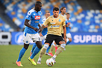 Andrea Petagna of SPAL challenges for the ball with Kalidou Koulibaly of SSC Napoli during the Serie A football match between SSC  Napoli and SPAL at stadio San Paolo in Naples ( Italy ), June 28th, 2020. Play resumes behind closed doors following the outbreak of the coronavirus disease. <br /> Photo Carmelo Imbesi / Insidefoto