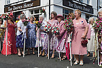 "Neston Female Friendly Society Annual Club Walking Day. Neston Cheshire UK 2015. Members at the ""Cross"", sing hyms and Land of Hope and Glory."