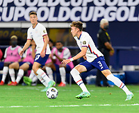 DALLAS, TX - JULY 25: Sam Vines #3 of the United States brings the ball up the field during a game between Jamaica and USMNT at AT&T Stadium on July 25, 2021 in Dallas, Texas.