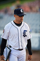 Connecticut Tigers pitching coach Carlos Bohorquez (15) walks to the dugout before a game against the Hudson Valley Renegades on August 20, 2018 at Dodd Stadium in Norwich, Connecticut.  Hudson Valley defeated Connecticut 3-1.  (Mike Janes/Four Seam Images)