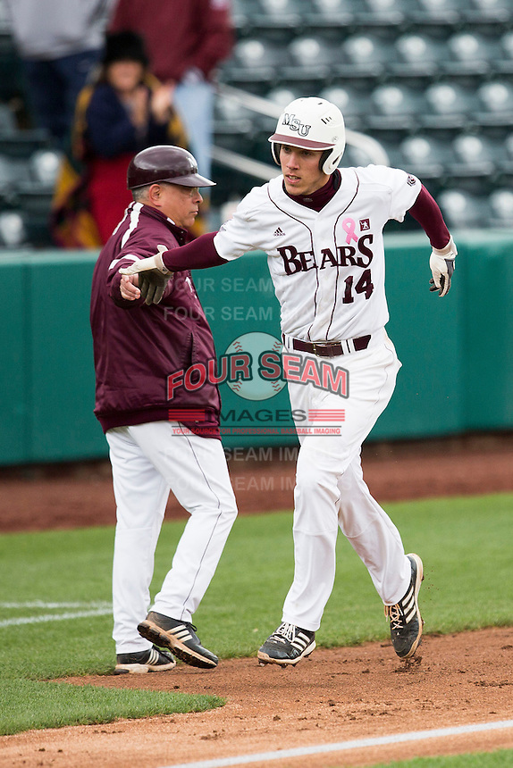 Eric Cheray #14 of the Missouri State Bears high fives Missouri State Bears head coach Keith Guttin after hitting a home run during a game against the Wichita State Shockers at Hammons Field on May 4, 2013 in Springfield, Missouri. (David Welker/Four Seam Images)