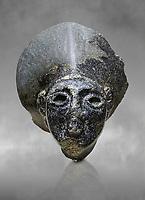 Hittite statue head of the Sun Goddess . Basalt, Hittie Period 1650 - 1450 BC. Hattusa Boğazkale. Çorum Archaeological Museum, Corum, Turkey. Against a grey bacground.
