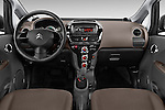 Stock photo of straight dashboard view of 2016 Citroen C-Zero Confort 5 Door Micro Car Dashboard