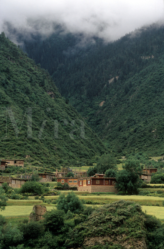 Flat roofed houses vary in decorative design from village to village - Kham (Eastern Tibet), Sichuan Province, China
