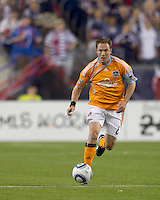 Houston Dynamo defender Richard Mulrooney (8) brings the ball forward. The New England Revolution defeated Houston Dynamo, 1-0, at Gillette Stadium on August 14, 2010.