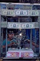 Money changer in a market of Phnom Penh, Cambodia