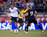 Carli Lloyd, Kirsty Yallop. The USWNT tied New Zealand, 1-1, at an international friendly at Crew Stadium in Columbus, OH.