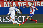 Atletico de Madrid's Siqueira (R) and Real Madrid´s Raphael Varane during quarterfinal first leg Champions League soccer match at Vicente Calderon stadium in Madrid, Spain. April 14, 2015. (ALTERPHOTOS/Victor Blanco)