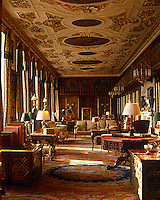 In the sumptuous library at Chatsworth, the gilded stucco ceiling by Edward Goudge frames paintings by Antonio Verrio which date to the 17th century