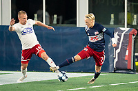 FOXBOROUGH, MA - OCTOBER 16: Derek Waldeck #18 of North Texas SC comes in to tackle Connor Presley #7 of New England Revolution II during a game between North Texas SC and New England Revolution II at Gillette Stadium on October 16, 2020 in Foxborough, Massachusetts.