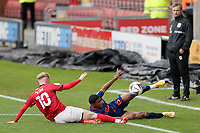 Blackpool's Demi Mitchell attempts to keep the ball in play under pressure from Crewe Alexandra's Charlie Kirk<br /> <br /> Photographer Rich Linley/CameraSport<br /> <br /> The EFL Sky Bet League One - Crewe Alexandra v Blackpool - Saturday 17th October 2020 - Gresty Road - Crewe<br /> <br /> World Copyright © 2020 CameraSport. All rights reserved. 43 Linden Ave. Countesthorpe. Leicester. England. LE8 5PG - Tel: +44 (0) 116 277 4147 - admin@camerasport.com - www.camerasport.com