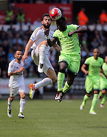 ( L-R ) Jordi Amat of Swansea City battles for a header against Bacary Sagna of Manchester City during the Swansea City FC v Manchester City Premier League game at the Liberty Stadium, Swansea, Wales, UK, Sunday 15 May 2016