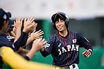 #25 Kitayama Miku high five with her teammates during the BFA Women's Baseball Asian Cup match between South Korea and Japan at Sai Tso Wan Recreation Ground on September 2, 2017 in Hong Kong. Photo by Marcio Rodrigo Machado / Power Sport Images