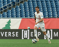 FOXBOROUGH, MA - JULY 9: Enric Bernat #71 of Toronto FC II dribbles at midfield during a game between Toronto FC II and New England Revolution II at Gillette Stadium on July 9, 2021 in Foxborough, Massachusetts.