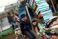 Wednesday 28 May 2014, Hay on Wye, UK<br /> Pictured: Young children playing by a sculpture made out of used books<br /> Re: The Hay Festival, Hay on Wye, Powys, Wales UK.