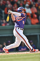 Clemson Tigers first baseman Andrew Cox (6) swings at a pitch during a game against the South Carolina Gamecocks at Fluor Field February 28, 2015 in Greenville, South Carolina. The Gamecocks defeated the Tigers 4-1. (Tony Farlow/Four Seam Images)