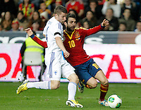 Spain's Cesc Fabregas (r) and Finland's Toivio during international match of the qualifiers for the FIFA World Cup Brazil 2014.March 22,2013.(ALTERPHOTOS/Victor Blanco)
