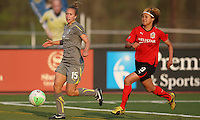 Nikki Krzysik (15) of the Philadelphia Independence beats Mami Yamaguchi (9) of the Atlanta Beat to the ball.  Atlanta and Philadelphia played to a 0-0 draw in the season opener for both teams at John A Farrell Stadium in West Chester, PA.
