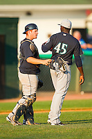 Pulaski Mariners catcher Tyler Marlette #30 has a chat with pitcher Domingo Brazoban #45 during the Appalachian League game against the Bluefield Blue Jays at Bowen Field on July 1, 2012 in Bluefield, West Virginia.  The Mariners defeated the Blue Jays 4-3.  (Brian Westerholt/Four Seam Images)