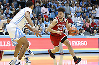 CHAPEL HILL, NC - FEBRUARY 25: Devon Daniels #24 of North Carolina State University drives with the ball during a game between NC State and North Carolina at Dean E. Smith Center on February 25, 2020 in Chapel Hill, North Carolina.