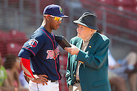 Cedar Rapids Kernels outfielder Byron Buxton #7 talks with Iowa media personality Bob Brooks following a game against the Lansing Lugnuts at Veterans Memorial Stadium on April 30, 2013 in Cedar Rapids, Iowa. (Brace Hemmelgarn/Four Seam Images)