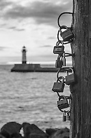 """""""Duluth Love Locks"""" ~ Apparently Duluth has its own version of Love Locks...<br /> In recent months, similar locks have been removed from bridges in Paris, Rome, and elsewhere due to structural problems caused by the cumulative weight (45 tons in one case!). According to BBC News, """"The custom is inspired by a book by novelist Federico Moccia in which a couple place a bicycle lock around a lamppost and throw the key into the Tiber. The gesture was meant to symbolise the couple eternally locking their hearts together.""""<br /> <br /> (P.S. If you love Duluth, purchase this photo or take a selfie here; please don't leave a lock. Leave no trace.)"""