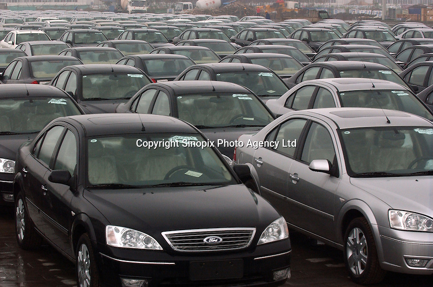 Ford cars are lined-up outside Chongqing Changan Automobile, the country's third-largest vehicle maker, outside the Chongqing plant.  American car manufacturer Ford has formed into a joint venture with the Chinese manufacturer..