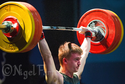 10 MAY 2014 - COVENTRY, GBR - Shaun Clegg from the Olympic Dragons Weightlifting Club attempts to hold a lift during the men's 77kg A category round at the British 2014 Senior Weightlifting Championships and final 2014 Commonwealth Games qualifying event round at the Ricoh Arena in Coventry, Great Britain. Clegg's combined total for the event of 291kg makes him eligible for selection for the England team for the Commonwealth Games in Glasgow (PHOTO COPYRIGHT © 2014 NIGEL FARROW, ALL RIGHTS RESERVED)
