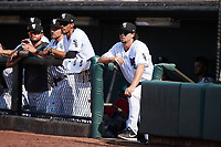 Winston-Salem Dash pitcher Taylor Varnell (right) watches from the dugout during the game against the Hickory Crawdads at Truist Stadium on July 10, 2021 in Winston-Salem, North Carolina. (Brian Westerholt/Four Seam Images)