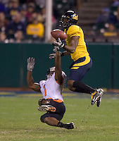 Steve Williams of California tries to intercept the ball away from James Rodgers of Oregon during the game at AT&T Park in San Francisco, California on November 12th, 2011.   California defeated Oregon State, 23-6.