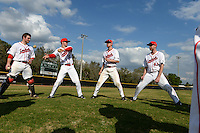 Ball State Cardinals Joe Stubbe (20), T.J. Baker (16), David Current (32) and Devin Wilburn (43) play two ball before a game against the Maine Black Bears on March 3, 2015 at North Charlotte Regional Park in Port Charlotte, Florida.  Ball State defeated Maine 8-7.  (Mike Janes/Four Seam Images)
