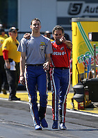 Mar. 15, 2013; Gainesville, FL, USA; NHRA pro stock motorcycle rider Hector Arana Sr (right) showing son Adam Arana the groove during qualifying for the Gatornationals at Auto-Plus Raceway at Gainesville. Mandatory Credit: Mark J. Rebilas-