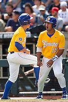 UC Santa Barbara Gauchos outfielder Devon Bradford (15) celebrates with teammate JJ Muno (9) after scoring against the Miami Hurricanes in Game 5 of the NCAA College World Series on June 20, 2016 at TD Ameritrade Park in Omaha, Nebraska. UC Santa Barbara defeated Miami  5-3. (Andrew Woolley/Four Seam Images)
