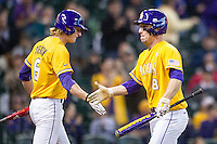 LSU Tigers shortstop Alex Bregman (8) celebrates at the plate with teammate Andrew Stevenson (6) after scoring during the Houston College Classic against the Nebraska Cornhuskers on March 8, 2015 at Minute Maid Park in Houston, Texas. LSU defeated Nebraska 4-2. (Andrew Woolley/Four Seam Images)