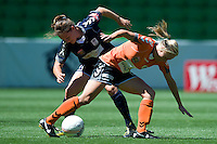 MELBOURNE, AUSTRALIA - DECEMBER 4: Kendall FLETCHER from Melbourne Victory and Tameka Butt of the Roar compete for the ball in round 5 of the Westfield W-league match between Melbourne Victory and Brisbane Roar on 4 December 2010 at AAMI Park in Melbourne, Australia. (Photo Sydney Low / asteriskimages.com)