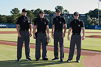 (L-R) Umpires Jesse Bush, Matt Blackbarow, Macon Hammond, and Lane Cullipher pose for a photo prior to the Low A East Championship game between the Down East Wood Ducks and the Charleston RiverDogs at Joseph P. Riley, Jr. Park on September 26, 2021 in Charleston, South Carolina. (Brian Westerholt/Four Seam Images)