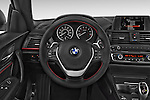 Car pictures of steering wheel view of a 2015 BMW 2 Series 228I Sport 2 Door Coupe 2WD Steering Wheel