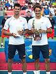 Roger Federer of Switzerland and Novak Djokovic of Serbia holding the winner and runner-up trophies at the Western & Southern Open in Mason, OH on August 19, 2012.