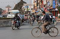 Nepal, Kathmandu.  Traffic on Durbar Marg Roundabout.  Narayanhiti Palace in the background, now a museum.