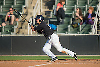 Eddy Alvarez (1) of the Kannapolis Intimidators follows through on his swing against the West Virginia Power at CMC-Northeast Stadium on April 21, 2015 in Kannapolis, North Carolina.  The Power defeated the Intimidators 5-3 in game one of a double-header.  (Brian Westerholt/Four Seam Images)
