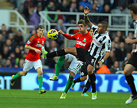 Saturday 17 November 2012<br /> Pictured L-R: Pablo Hernandez of Swansea challenging Danny Simpson of Newcastle. <br /> Re: Barclay's Premier League, Newcastle United v Swansea City FC at St James' Park, Newcastle Upon Tyne, UK.