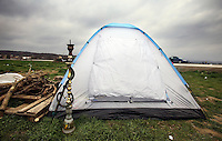 Pictured: A hookah outside one of the tents in the camp Monday 29 February 2016<br /> Re: A crowd of migrants has burst through a barbed-wire fence on the FYRO Macedonia-Greece border using a steel pole as a battering ram.<br /> TV footage showed migrants pushing against the fence at Idomeni, ripping away barbed wire, as FYRO Macedonian police let off tear gas to force them away.<br /> A section of fence was smashed open with the battering ram. It is not clear how many migrants got through.<br /> Many of those trying to reach northern Europe are Syrian and Iraqi refugees.<br /> About 6,500 people are stuck on the Greek side of the border, as FYRO Macedonia is letting very few in. Many have been camping in squalid conditions for a week or more, with little food or medical help.