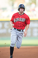 John Bowker (19) of the Indianapolis Indians hustles towards third base against the Charlotte Knights at BB&T BallPark on June 20, 2015 in Charlotte, North Carolina.  The Knights defeated the Indians 6-5 in 12 innings.  (Brian Westerholt/Four Seam Images)