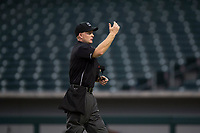 Home plate umpire Austin Nelson calls for AZL Cubs 2 manager Jonathan Mota (not pictured) onto the field to explain the ruling on the field during an Arizona League game between the AZL Rangers and the AZL Cubs 2 at Sloan Park on July 7, 2018 in Mesa, Arizona. AZL Rangers defeated AZL Cubs 2 11-2. (Zachary Lucy/Four Seam Images)
