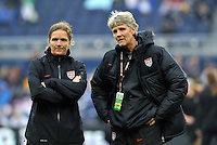 USWNT Assistant Coach Hege Riise talking with USWNT Head Coach Pia Sundhage.