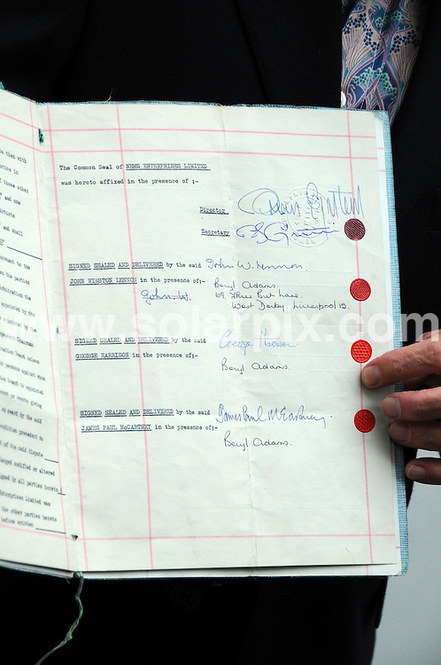**ALL ROUND PICTURES FROM SOLARPIX.COM**.**WORLDWIDE SYNDICATION RIGHTS**.the first fully signed contract between the Beatles and Brian Epstein. expected to fetch £250.000 at auction. Idea Generation Gallery, London, UK. 19th August 2008..JOB REF: 7057 MSR    DATE: 19_08_2008.**MUST CREDIT SOLARPIX.COM OR DOUBLE FEE WILL BE CHARGED* *UNDER NO CIRCUMSTANCES IS THIS IMAGE TO BE REPRODUCED FOR ANY ONLINE EDITION WITHOUT PRIOR PERMISSION*