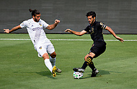 LOS ANGELES, CA - AUGUST 22: Carlos Vela #10 of LAFC attempts to move past Emiliano Insua #3  of the Los Angeles Galaxy during a game between Los Angeles Galaxy and Los Angeles FC at Banc of California Stadium on August 22, 2020 in Los Angeles, California.