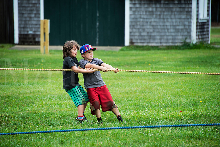 Kids tug of war contest at the Martha's Vineyard Harvest fest, West Tisbury, Massachusetts, USA