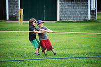 Kids tug of war contest at the Martha's Vineyard Harvest fest, West Tisbury, Massachusetts, USA